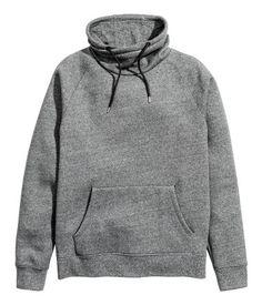 Dark gray melange. Sweatshirt with long raglan sleeves. Wrapover chimney collar with drawstring, kangaroo pocket at front, and ribbing at cuffs and hem.