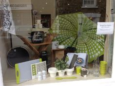 Herdy brollies in the window of Salcombe Trading Company.