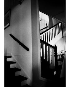 This interior black and white photograph of the staircase in a New England hotel is almost surreal with its soft light and mirror reflection.
