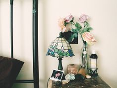 Bedside table, love the Tiffany style lamp