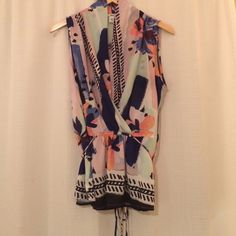 Bar III Sleeveless Blouse 100% polyester. Draped in front. Tie in back. Great condition! Bar III Tops Tank Tops