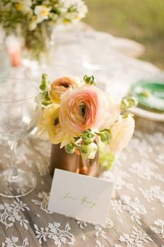 Vintage chic centerpiece. You could even give the vase/mug to a special guest, as a gift.