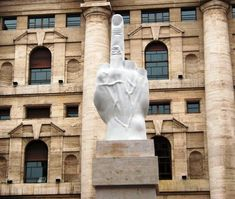 There is a giant middle finger statue in front of Milan Stock Exchange building. The high statue known as The Middle Finger is created by the Italian contemporary artist Maurizio Cattelan. Stuck In The Middle, Pope John, Italian Artist, Contemporary Artists, Statues, Statue Of Liberty, Places To See, Milan, Beautiful Places