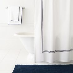 "Deep ink-blue embroidery brings shimmer texture to this classic white shower curtain. Coordinate with our Signature Banded White/Indigo bath towels and Signature Indigo bath rugs. Dimensions: 72"" x 72"