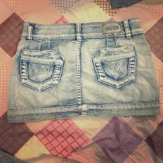 Denim mini skirt with gems  Worn like 4 times. Some of the gems in the front are not there but it's not noticeable. Skirts Mini