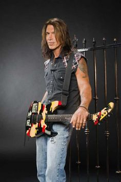 George Lynch. Lynch Mob and Dokken. Fantastic guitarist. He's also easy on the eye's too ;)