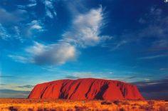 Visit Ayers Rock in Australia.