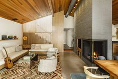 Before & After A Midcentury Lakeside Home Receives a Stunning New Look is part of Living Room Layout With Staircase - An old home in Lake Oswego, Oregon, receives a modern makeover from MOA Architecture, while keeping its midcentury charm intact Living Room With Fireplace, Living Room Sofa, Home Living Room, Living Room Decor, Small Living Room Design, Living Room Modern, Living Room Designs, Living Spaces, Mid Century Living Room