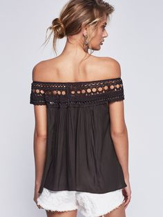 Feel Free Top | In a shapeless silhouette this semi-sheer flowy top has a rounded neckline with macramé detailing and metal hardware detailing. Can be worn off-the-shoulder.