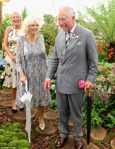 The Prince of Wales and Duchess of Cornwall were left in stitches today after seeing papiermâché models of themselves at Sandringham Flower Show