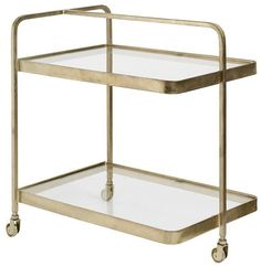 Nordal+-+Rullebord+m/3+hjul+-+Messingfarvet+-+Smukt+og+feminint+rullebord+i+messinglook.+Rullebordet+er+dansk+design+og+utrolig+smukt.+Bordet+har+mange+anvendelsesmuligheder-+og+funktioner.+Brug+det+blandt+andet+som+bord,+til+servering+eller+anretning.+Det+er+kun+til+indendørs+brug.+Dette+produkt+er+delvist+håndlavet,+og+derfor+kan+uregelmæssigheder+samt+variationer+i+farver,+finish+og+størrelser+forekomme,+hvilket+er+en+del+af+produktets+unikke+look.