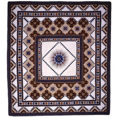 """Ray of Light is one of the most-recognized American quilts. In 1977, at the height of the resurgence of quiltmaking, it won the Good Housekeeping and U.S. Historical Society contest for The Great American Quilt, besting 10,000 entries.    This traditional medallion quilt features a central compass design (look at those points!) and multiple """"frames"""" of smaller compasses, sawtooth-edged blocks and incredibly fine quilting. Jinny used both American and Indonesian fabrics."""