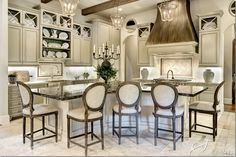 Favorite cabinet and hood color...love...Stunning French Country Kitchen!