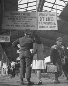 US soldier and local girl reading military restrictions about riding trains. Japan, 1946. Photo by John Florea. The U.S Naval base at Yokosuka still exists. S)
