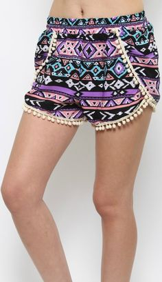 Perfect for the beach or everyday wear, our Mikalya Shorts are essential shorts this season. Pom pom detailing. 100% Polyester.