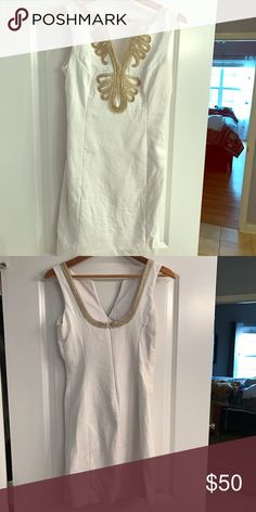 Lily Pulitzer white mini dress Lily Pulitzer white mini dress with gold embellishment. It has been taken in. Bought at size 2 but is more of a size 0 now. Lilly Pulitzer Dresses Mini