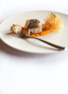 Crispy skin Barramundi with carrot and ginger puree and coriander butter, pomme allumette