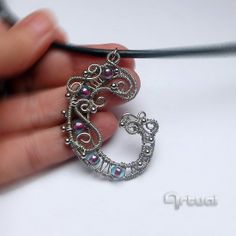 """One of a kind wire wrapped """"G"""" initial pendant embellished with glass beads"""