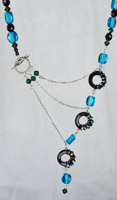 Jet Black, Peacock Blue and Emerald Wire Wrapped Circle Adrienne Adelle Signature Necklace.  Copyright adrienneadelle.com