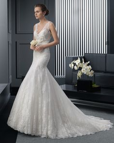 Long beaded lace and organza wedding dress with flower. Two by Rosa Clará 2015 Collection