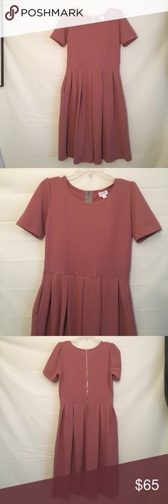NWT LuLaRoe Large Amelia Dress Brand new LuLaRoe Amelia size large dress .... ....... BUNDLE 2 or More SAVE 20%!!! Spend $20 or more and choose a FREE GIFT!!!!Choose your free gift by either commenting on the gift or commenting on one of the items you purchased indicating which # gift you would like!! $$20 purchase or More ONLY!!! LuLaRoe Dresses Midi