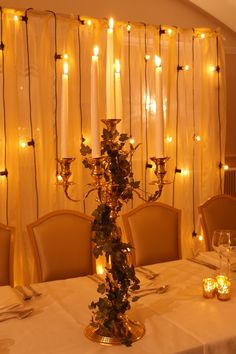 Brass table candelabra dressed with ivy, plus rustic lace and festoon backdrop by www.stressfreehire.com #venuetransformers