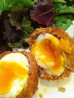 Scotch eggs with golden runny yolk http://www.reddit.com/r/food/comments/12iyzp/scotch_eggs_with_golden_runny_yolk/