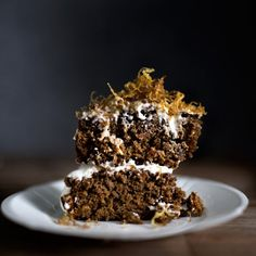 Deep dark and spicy carrot gingerbread cake, with cardamon cream cheese frosting and crispy sugared ginger fries.