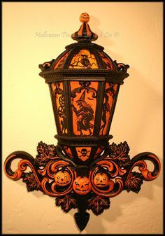 DIY Halloween Decor Made With Home Interior Wall Lantern~ I have this piece so now I have the inspiration to make one like this!!