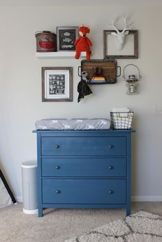 Love this funky, outdoor-inspired gallery wall over the changing table! #nursery