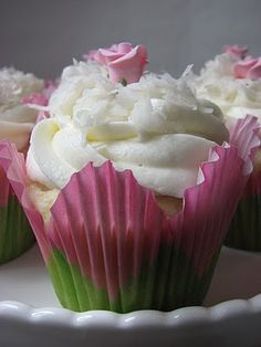 Coconut cupcakes in tulip wrappers - I hope Michaels still has the cute wrappers.