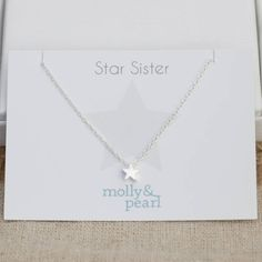 """Delicate sterling silver star necklace, made just for your star sister!This is a beautiful but simple sterling silver star necklace and would make a lovely gift for your sister. The perfect gift for letting her know what a star she is! The chain length is adjustable and the star sits perfectly against the neck. The necklace is presented wrapped in tissue paper within a Molly & Pearl gift box.  925 sterling silver <strong>18"""" adjustable chain</strong>"""