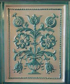 Tulips and pomegranate adorn this unusually turquoise Tyrolean stube Tile #cabanamood #tiles #tyrolean #alpinemood