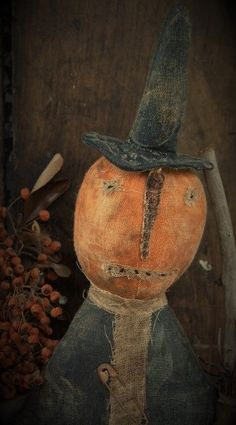 Pumpkin Witch. This pumpkin witch is stained, painted and sanded for a great time worn primitive look. Her face is hand stitched and she has a