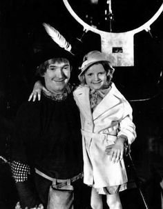 Stan Laurel on the set with his daughter Lois.