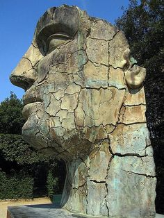 this is found in the Boboli Gardens in Florence, Tindaro Screpolato is an enormous bronze statue by sculptor Igor Mitoraj. Please keep credits intact.