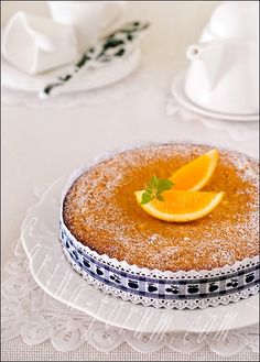 Flourless orange-almond cake  The recipe is based on the Sephardic orange-and-almond cake in Claudia Roden's «The New Book of Middle Eastern Food». It is moist, fragrant, dense, delicate, light and not too sweet and utterly irresistible cake, perfect for any time of day