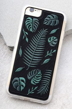 Give your phone a surprise makeover with the Zero Gravity Fern Black Embroidered iPhone 6 and 6s Case! This plastic case has a slim profile with clear, flexible rubber sides, raised front lip, and access to all ports. Green leaf embroidery. Fits iPhone 6 and 6s.