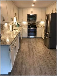 63 New Ideas For Grey Wood Tile Kitchen Floor White Cabinets Wood Tile Kitchen, Kitchen Flooring, Kitchen Countertops, New Kitchen, Kitchen White, Tile Wood, Marble Wood, Kitchen Cabinets, Concrete Countertops