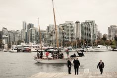 bridal party arriving via boat at the vancouver rowing club Rowing Club, Stanley Park, San Francisco Skyline, Vancouver, New York Skyline, Boat, Wedding Ideas, Bridal, Party