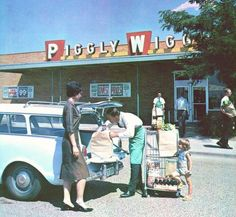 Piggly Wiggly Supermarket Clerk loading a suburban housewife's Rambler Wagon