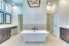 I could live in this bathroom. Check out the 12x24 floor tile layed on herringbone
