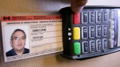 """Although a status card allows """"registered Indians"""" access to some benefits,  it's not a credit card and it's not a free pass."""