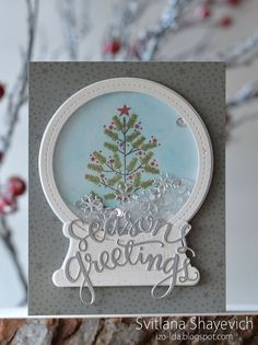 What a pretty, glittering snow globe!  Sequins and diamond dust sparkle inside the shaker card. The stamped Christmas tree could be any shape you like for a variation on this handmade card.