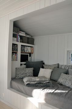 I love cutouts. Wall cutout with couch and bookshelf.