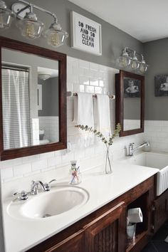 great double sinks and white tile in the bathroom. that farmhouse sink is great for bathing new babies