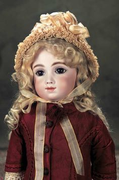 "FRENCH BISQUE BEBE A.T., SIZE 11 ~ by: Thuillier 23"".  Bisque swivel head on kid-edged bisque shoulder plate, very full cheeks + throat, amber brown glass paperweight inset eyes...marks: A 11 T.  COMMENTS: Thuillier, the early model of the luxury bebe, c. 1884"