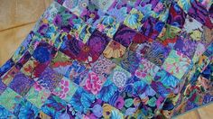 Quilt from Kaffe Fassett fabrics. You could easily make this with our charm packs we have in stock. Strip Quilts, Patch Quilt, Quilt Blocks, Charm Square Quilt, Charm Quilt, Batik Quilts, Patchwork Quilting, Blue Quilts, Quilt Modernen