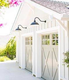 Garage doors and farmhouse lighting