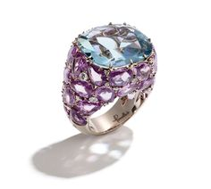 Pomellato - 18k white gold with facetted cushion aquamarine, rose cut pink sapphires, and brilliant cut diamonds.
